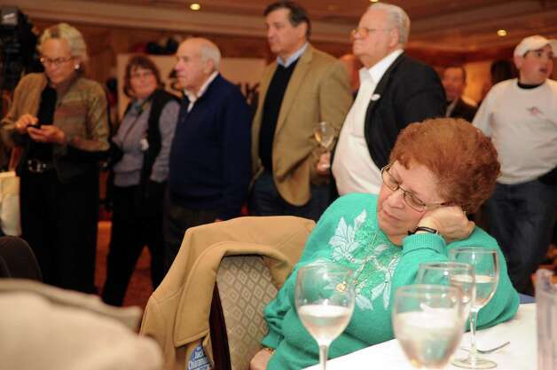 A supporter of Steve Obsitnik, Republican candidate for Congress, rests her eyes at the Norwalk Inn in Norwalk, Conn., on Tuesday, November 6, 2012. Photo: Lindsay Niegelberg / Stamford Advocate