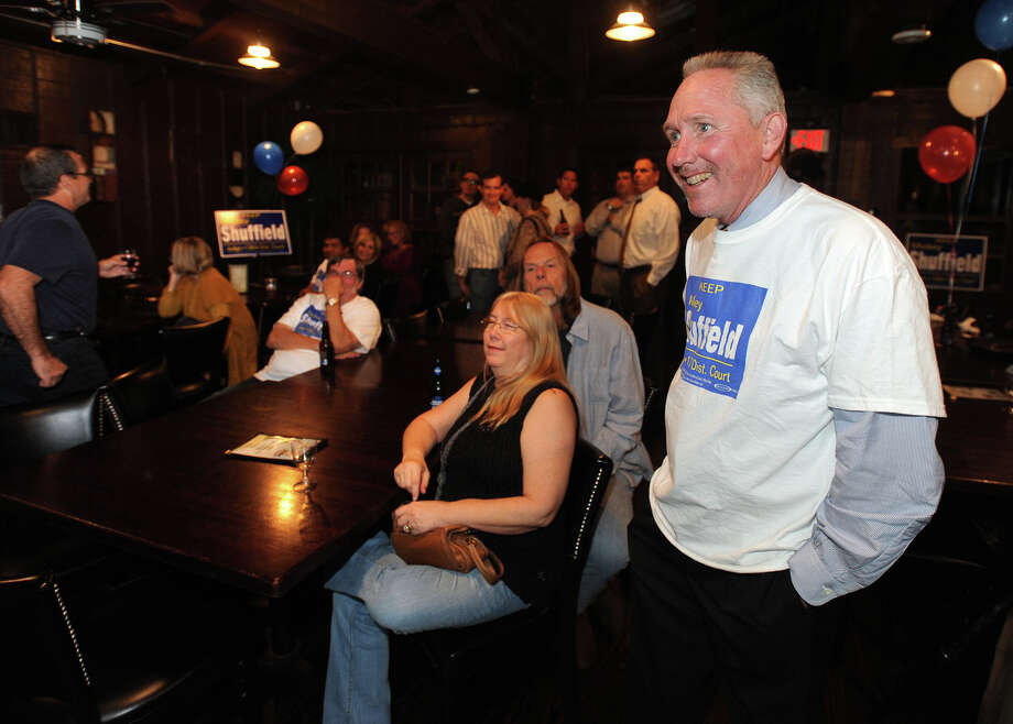 Judge Mickey Sheffield and his supporters cheer at Starvin Marvin's Tuesday night as early numbers indicate his re-election to the 136th District Court.  Photo taken Tuesday, November 06, 2012 Guiseppe Barranco/The Enterprise Photo: Guiseppe Barranco, STAFF PHOTOGRAPHER / The Beaumont Enterprise