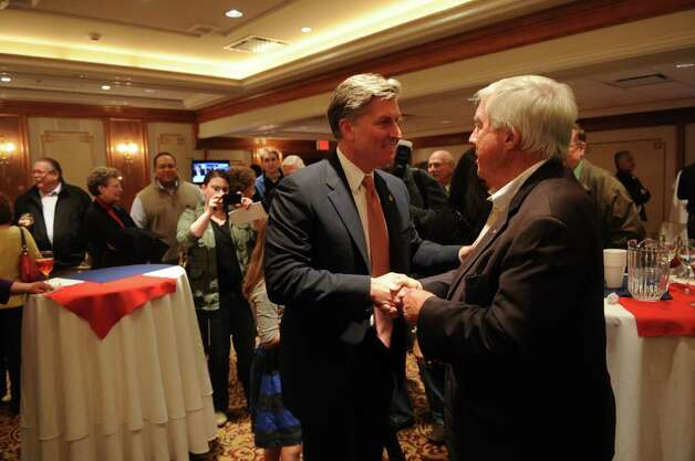Steve Obsitnik, Republican candidate for U.S. Congress, greets supporters as he arrives at the Norwalk Inn in Norwalk, Conn., on Tuesday, November 6, 2012. Photo: Lindsay Niegelberg / Stamford Advocate