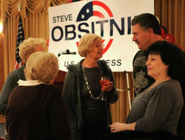 Supporters of Steve Obsitnik, Republican candidate for Congress, talk as they wait for election results at the Norwalk Inn in Norwalk, Conn., on Tuesday, November 6, 2012. Photo: Lindsay Niegelberg / Stamford Advocate