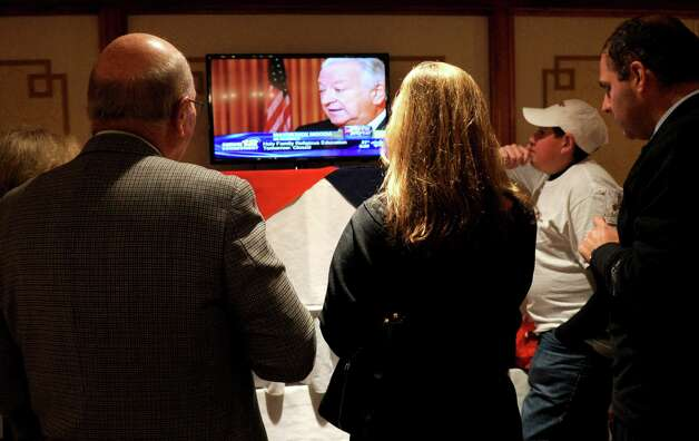 Supporters of Steve Obsitnik, Republican candidate for Congress, watch Norwalk Mayor Richard Moccia on television as he gives the interview from across the room at the Norwalk Inn in Norwalk, Conn., on Tuesday, November 6, 2012. Photo: Lindsay Niegelberg / Stamford Advocate
