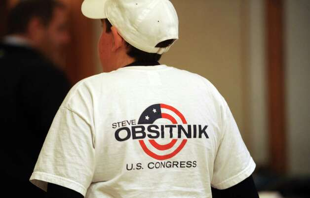 Supporters of Steve Obsitnik, Republican candidate for Congress, watch election results come in on television at the Norwalk Inn in Norwalk, Conn., on Tuesday, November 6, 2012. Photo: Lindsay Niegelberg / Stamford Advocate