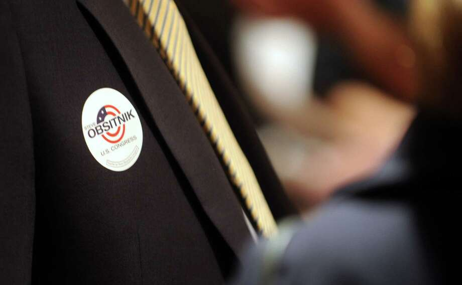 A supporter of Steve Obsitnik, Republican candidate for Congress, wears a sticker as he watches election results come in on television at the Norwalk Inn in Norwalk, Conn., on Tuesday, November 6, 2012. Photo: Lindsay Niegelberg / Stamford Advocate