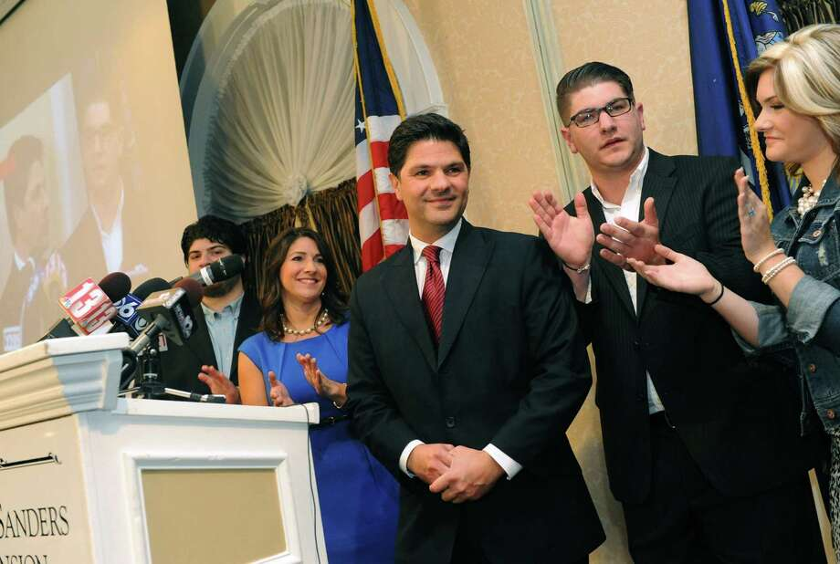 Republican candidate for the New York Senate 46th district George Amedore, center, is applauded by family members after declaring victory at the Glen Sanders Mansion in Scotia, NY Tuesday Nov. 6, 2012. (Michael P. Farrell/Times Union) Photo: Michael P. Farrell