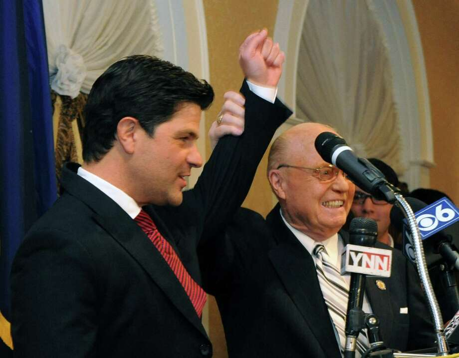 Incumbent State Senator Hugh T. Farley, right, holds up Republican candidate for the New York Senate 46th district George Amedore hand up in victory at the Glen Sanders Mansion in Scotia, NY Tuesday Nov. 6, 2012. (Michael P. Farrell/Times Union) Photo: Michael P. Farrell