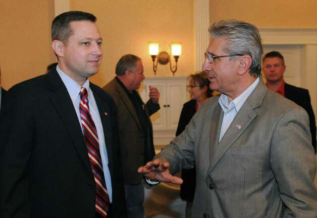 Assemblyman  Jim Tedisco, right, talks with congressional candidate Bob Dieterich at the Glen Sanders Mansion in Scotia, NY Tuesday Nov. 6, 2012. (Michael P. Farrell/Times Union) Photo: Michael P. Farrell
