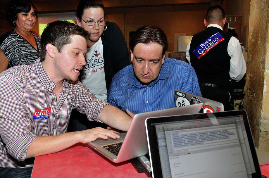 Pete Gallego reviews returns with Michael Beckendorf (left) during the election night watch party for State Representative Pete Gallego, D-Alpine, who is challenging U.S. Representative Francisco Canseco for his seat in the U.S. House District 23  on November 6, 2012. Photo: Tom Reel, San Antonio Express-News / ©2012 San Antono Express-News