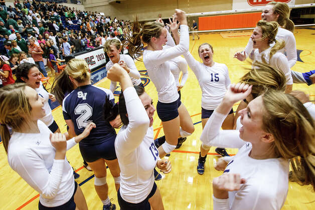 The Smithson Valley Lady Rangers celebrate their victory over Reagan during their Class 5A third round volleyball match at the UTSA Convocation Center on Nov. 6, 2012.  Smithson Valley won the match in three straight sets: 25-23, 25-21 and 25-19.  MARVIN PFEIFFER/ mpfeiffer@express-news.net Photo: MARVIN PFEIFFER, Express-News / Express-News 2012