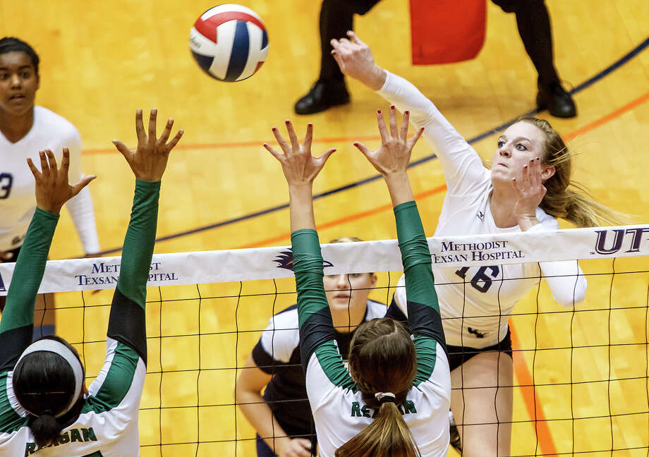 Smithson Valley's Allison Meckel (right) puts up a shot over the Reagan defense during their Class 5A third round volleyball match at the UTSA Convocation Center on Nov. 6, 2012.  Smithson Valley won the match in three straight sets: 25-23, 25-21 and 25-19.  MARVIN PFEIFFER/ mpfeiffer@express-news.net Photo: MARVIN PFEIFFER, Express-News / Express-News 2012
