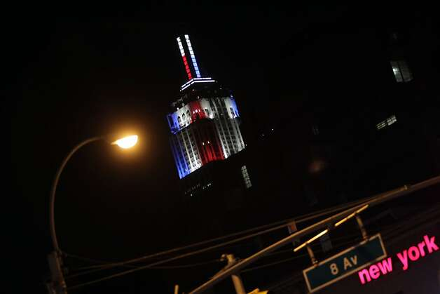 A view of the Empire State Building in New York, New York that is projecting an LED illuminated meter to show the results of the 2012 Presidential Election as CNN counts the numbers of electoral votes for each candidate, showing US President Barack Obama in blue and Mitt Romney in red, as polling in each state closes on November 6, 2012. AFP PHOTO/Mehdi TaamallahMEHDI TAAMALLAH/AFP/Getty Images Photo: Mehdi Taamallah, AFP/Getty Images