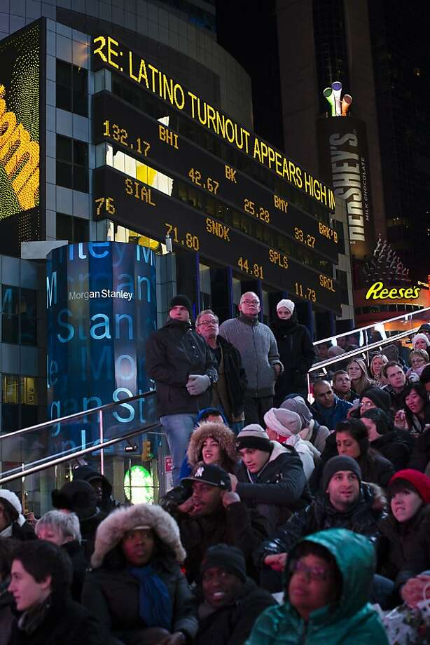 Crowds in Times Square watch election results, Tuesday, Nov. 6, 2012, in New York. After a year of campaigning, polls have begun to close after Americans across the United States headed to the polls to decide the winner of the tight presidential race between President Barack Obama and Republican presidential candidate, former Massachusetts Gov. Mitt Romney. (AP Photo/ John Minchillo) Photo: John Minchillo, Associated Press