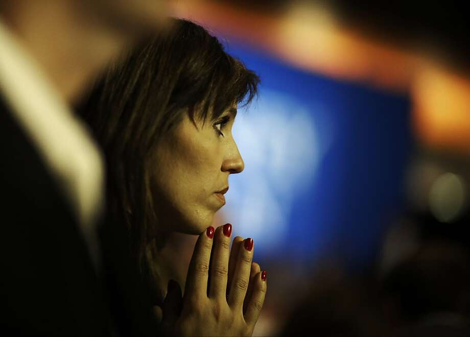 Nancy French, from Columbia, Tenn., watches vote results displayed on a television during Republican presidential candidate and former Massachusetts Gov. Mitt Romney's election night rally, Tuesday, Nov. 6, 2012, in Boston. (AP Photo/David Goldman) Photo: David Goldman, Associated Press