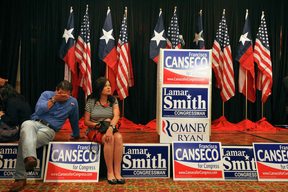 """Volunteers Jay Ibarra and Mary Whistler wait for results at the U.S. Rep. Francisco """"Quico"""" Canseco campaign rally at the Holiday Inn Airport on Election Night, Tuesday, Nov. 6, 2012. Canseco headed up to a """"war room,""""  to watch the election returns. He is scheduled to meet with supporters later on in the evening. Canseco is in a race with Democrat St. Rep. Pete Gallego, D-Alpine. Photo: Jerry Lara, San Antonio Express-News / © 2012 San Antonio Express-News"""