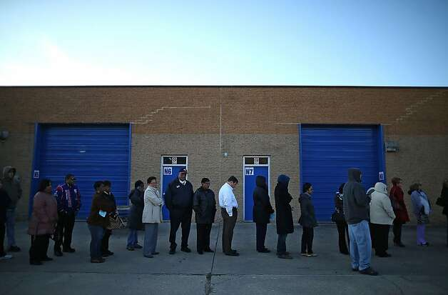 MILFORD, VA - NOVEMBER 06:  People wait in line to vote at Caroline High School on November 6, 2012 in Milford, Virginia. The swing state of Virginia is recognised to be a hotly contested battleground that offers 13 votes, with recent polls showing that the race between U.S. President Barack Obama and Republican presidential candidate Mitt Romney remains tight.  (Photo by Mark Wilson/Getty Images) Photo: Mark Wilson, Getty Images