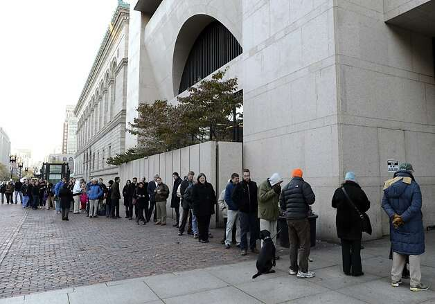 Voters line up to cast their vote at the Boston Public Library  November 6, 2012 in Boston, Massachusetts.  The final national polls showed an effective tie, with either US President Barack Obama or Republican challenger Mitt Romney favored by a single point in most surveys. AFP PHOTO / TIMOTHY A. CLARYTIMOTHY A. CLARY/AFP/Getty Images Photo: Timothy A. Clary, AFP/Getty Images