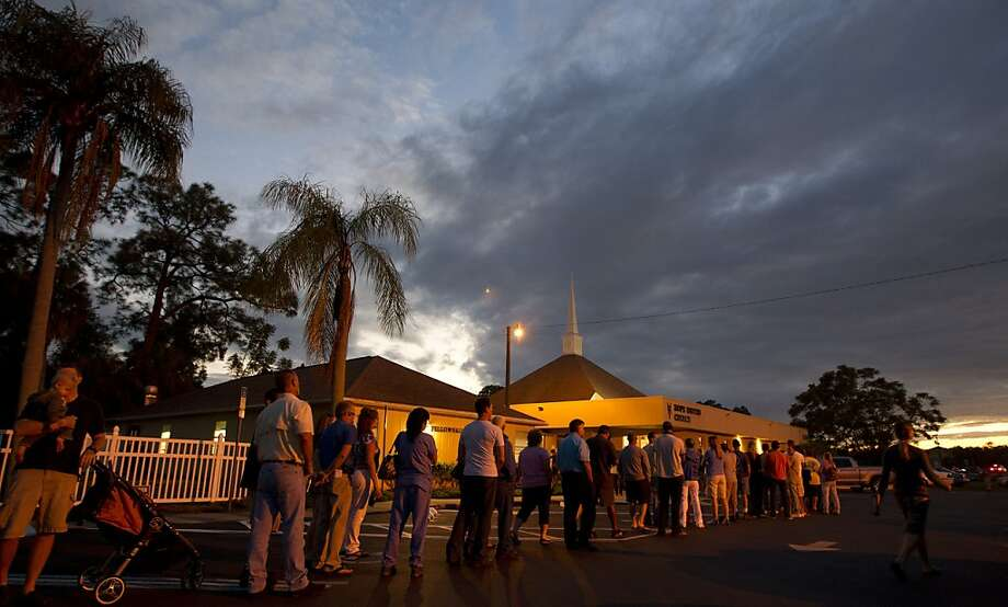 Voters stand in line at a Fort Myers, Fla. church late Tuesday, Nov. 6, 2012. After a grinding presidential campaign President Barack Obama and Republican presidential candidate, former Massachusetts Gov. Mitt Romney, yield center stage to American voters Tuesday for an Election Day choice that will frame the contours of government and the nation for years to come.  (AP Photo/J Pat Carter) Photo: J Pat Carter, Associated Press