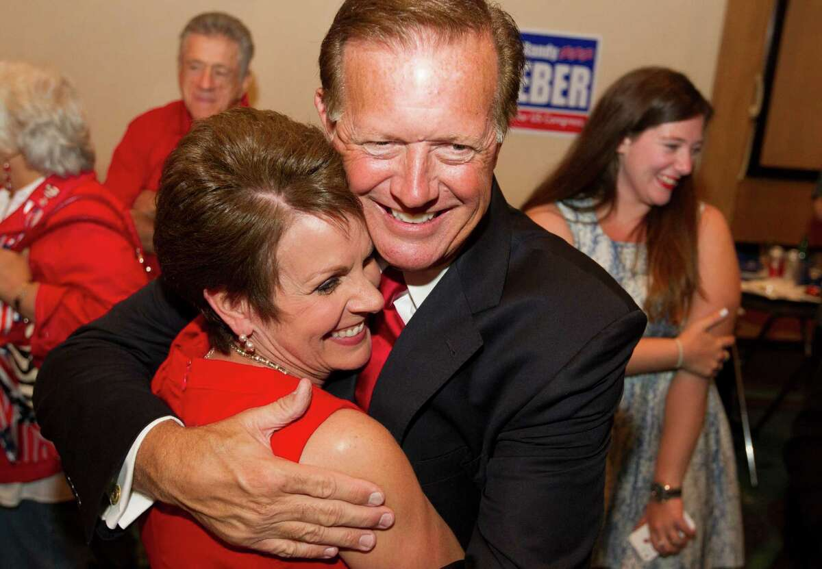 Republican candidate for Congressional District 14 Randy Weber is hugged by his wife Brenda after hearing early election returns at the South Shore Harbor Resort and Conference Center on Tuesday, Nov. 6, 2012, in League City. ( J. Patric Schneider / For the Chronicle )