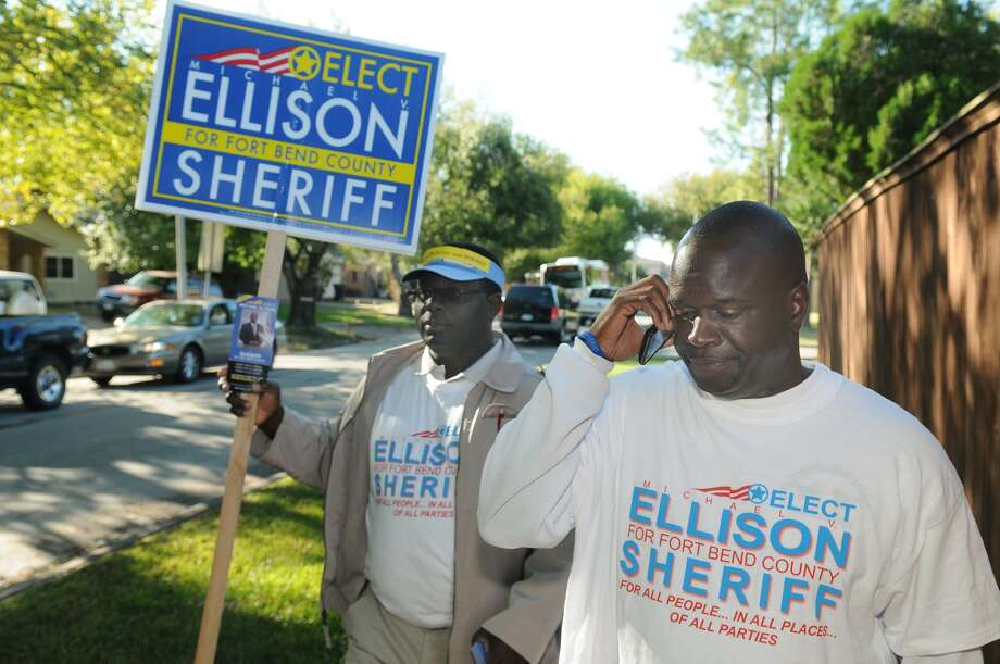 Michael Ellison, candidate for Sheriff of Fort Bend County, walks the streets near Ridgegate Elementary School while greeting voters and residents on Election Day. Freelance photo by Jerry Baker Photo: Jerry Baker, Freelance