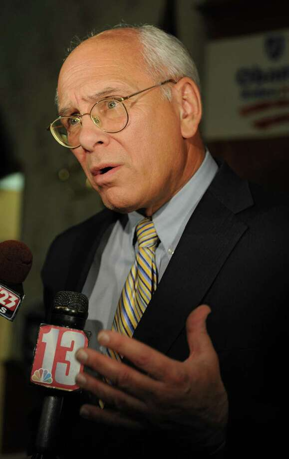Congressman Paul Tonko talks to the press at the Polish American Citizen's Club on election night Tuesday, Nov. 6, 2012 in Albany, N.Y.  (Lori Van Buren / Times Union) Photo: Lori Van Buren