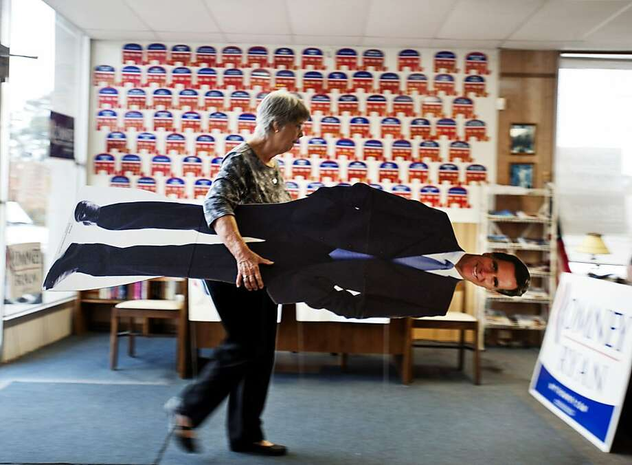 Next stop, eBay? At the Chatham County Republican Campaign office in Savannah, Ga., volunteer Clare Frew puts away actual-size Mitt Romney for the last time. Photo: Stephen Morton, Associated Press