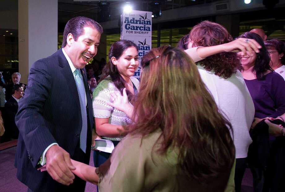 Harris County Sheriff Adrian Garcia gives hugs to his family members after giving a victory speech to his supporters as he holds a lead in the election, Tuesday, Nov. 6, 2012 in Houston. ( Nick de la Torre / Houston Chronicle ) Photo: Nick De La Torre, Staff / © 2012  Houston Chronicle