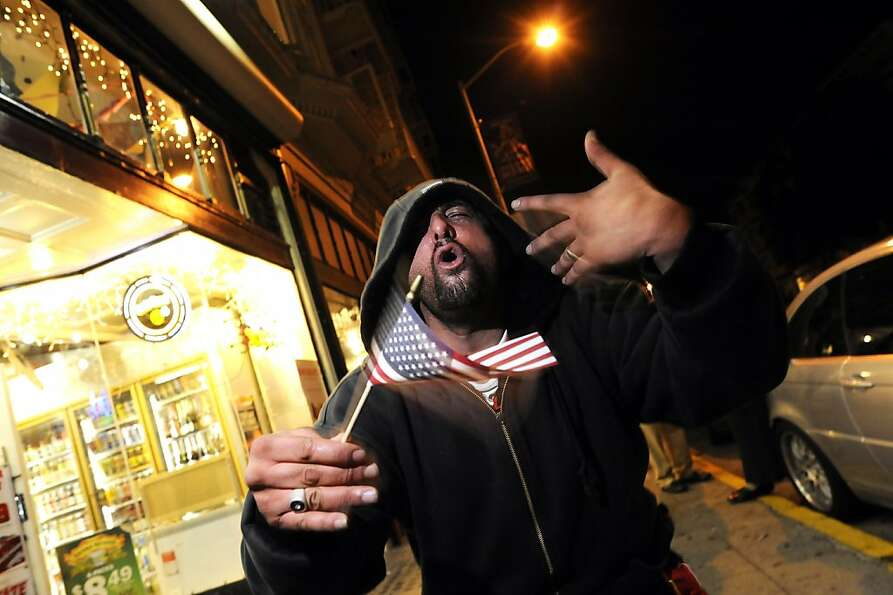 Michael Malak celebrates President Obama's victory outside the Golden Eagle Market on Valencia Stree