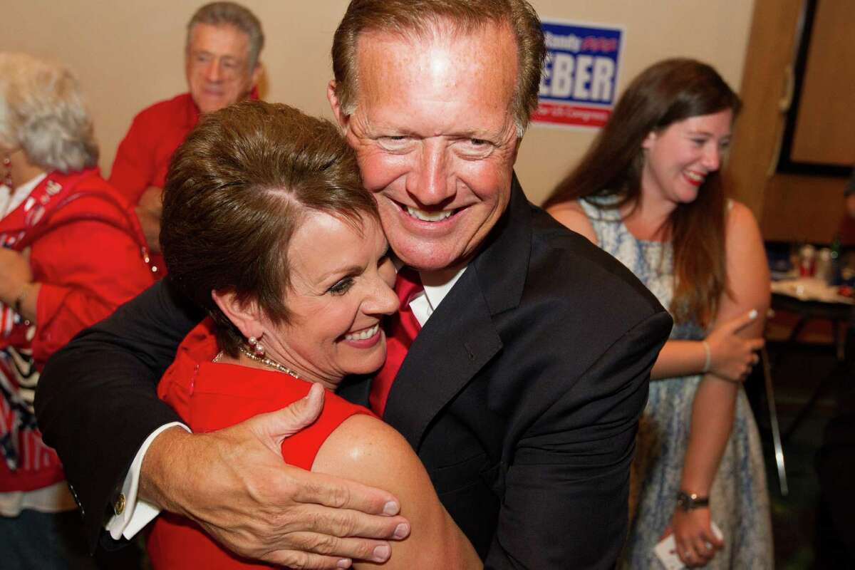 Randy Weber, Republican candidate for Congressional District 14i, s hugged by his wife Brenda after hearing early election returns at the South Shore Harbor Resort and Conference Center on Tuesday, Nov. 6, 2012, in League City.