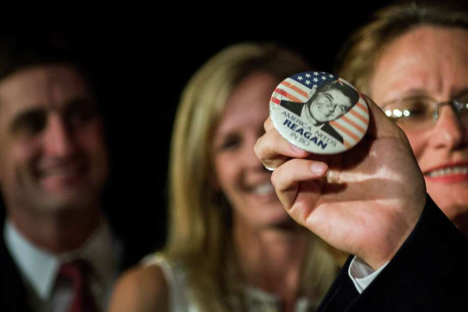 Republican candidate for U.S. Senate Ted Cruz holds up a vintage campaign button for Ronald Reagan as he addresses an election night watch party at the Hilton Post Oak hotel on Tuesday, Nov. 6, 2012, in Houston. Cruz defeated Democrat Paul Sadler to replace retiring U.S. Sen. Kay Bailey Hutchison. Photo: Smiley N. Pool, Houston Chronicle / © 2012  Houston Chronicle