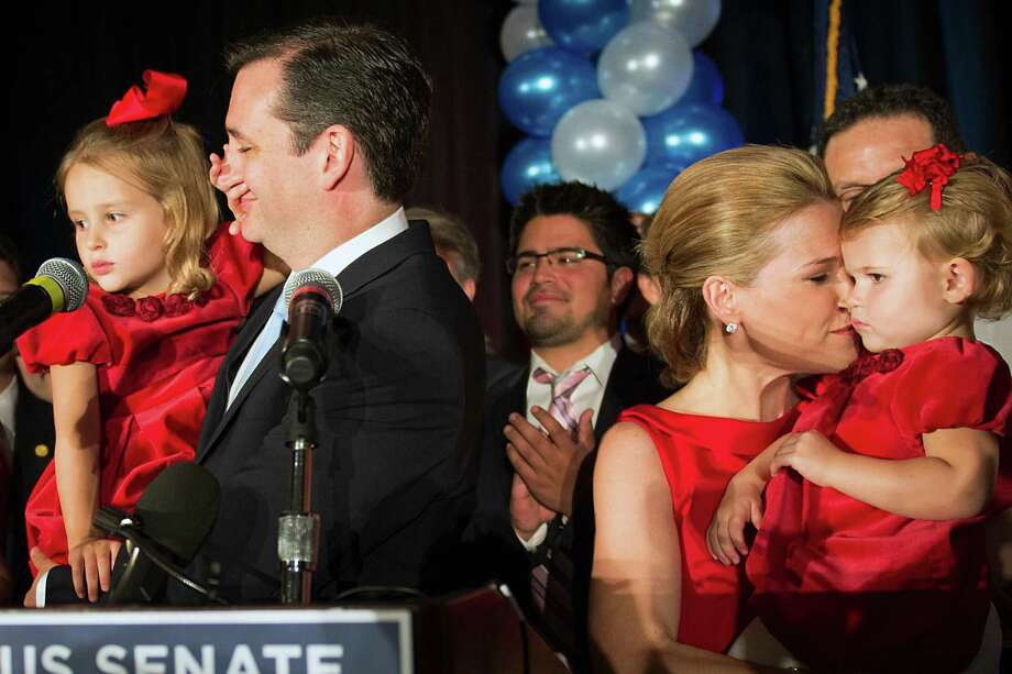 Republican candidate for U.S. Senate Ted Cruz gets a hand over his face from daughter Caroline as his wife Heidi holds daughter Catherine during an election night watch party at the Hilton Post Oak hotel on Tuesday, Nov. 6, 2012, in Houston. Cruz defeated Democrat Paul Sadler to replace retiring U.S. Sen. Kay Bailey Hutchison. Photo: Smiley N. Pool, Houston Chronicle / © 2012  Houston Chronicle
