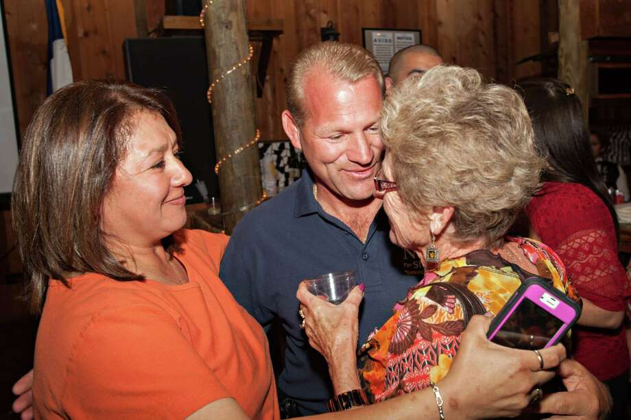 Troy Nehls receives congratulations from his mother, right, and supporters after winning the race for Fort Bend County Sheriff on Tuesday, November 6, 2012 in Richmond, Texas. Photo: Bob Levey, Houston Chronicle / ©2012 Bob Levey