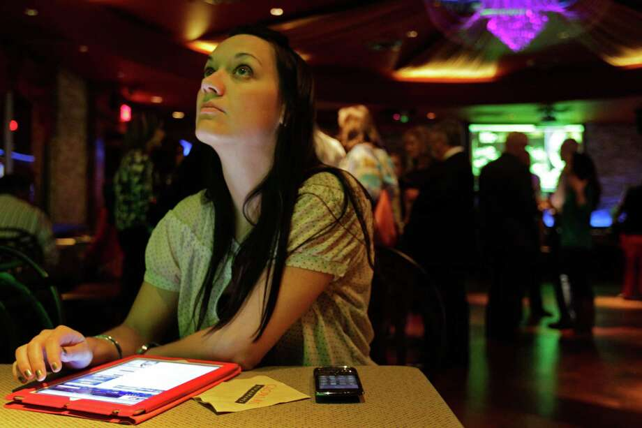 Sara Marie Kinney, campaign manager for Harris County district attorney candidate Mike Anderson, monitors election results during watch party Gloria's, 2616 Louisiana,  Tuesday, Nov. 6, 2012, in Houston. Photo: Melissa Phillip, Houston Chronicle / © 2012 Houston Chronicle