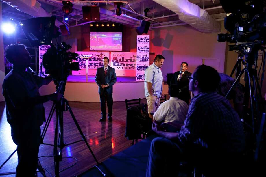 Members of the local media set up at Harris County Sheriff Adrian Garcia's election night party, Tuesday, Nov. 6, 2012 in Houston. Photo: Nick De La Torre, Houston Chronicle / © 2012  Houston Chronicle