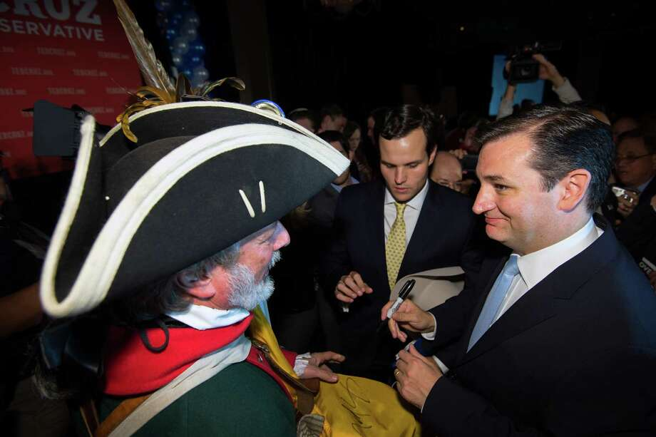 Republican candidate for U.S. Senate Ted Cruz, right, signs an autograph for supporter William Temple during an election night watch party at the Hilton Post Oak hotel on Tuesday, Nov. 6, 2012, in Houston. Cruz defeated Democrat Paul Sadler to replace retiring U.S. Sen. Kay Bailey Hutchison. Photo: Smiley N. Pool, Houston Chronicle / © 2012  Houston Chronicle