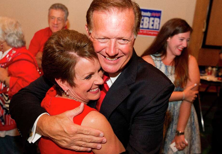 Republican candidate for Congressional District 14, state Sen. Randy Weber is hugged by his wife Brenda after hearing early election returns at the South Shore Harbor Resort and Conference Center on Tuesday, Nov. 6, 2012, in League City, Texas. Weber is facing Democratic Congressman Nick Lampson to replace the retiring Ron Paul. (AP Photo/Houston Chronicle, J. Patric Schneider) MANDATORY CREDIT Photo: J. Patric Schneider, Associated Press / Houston Chronicle