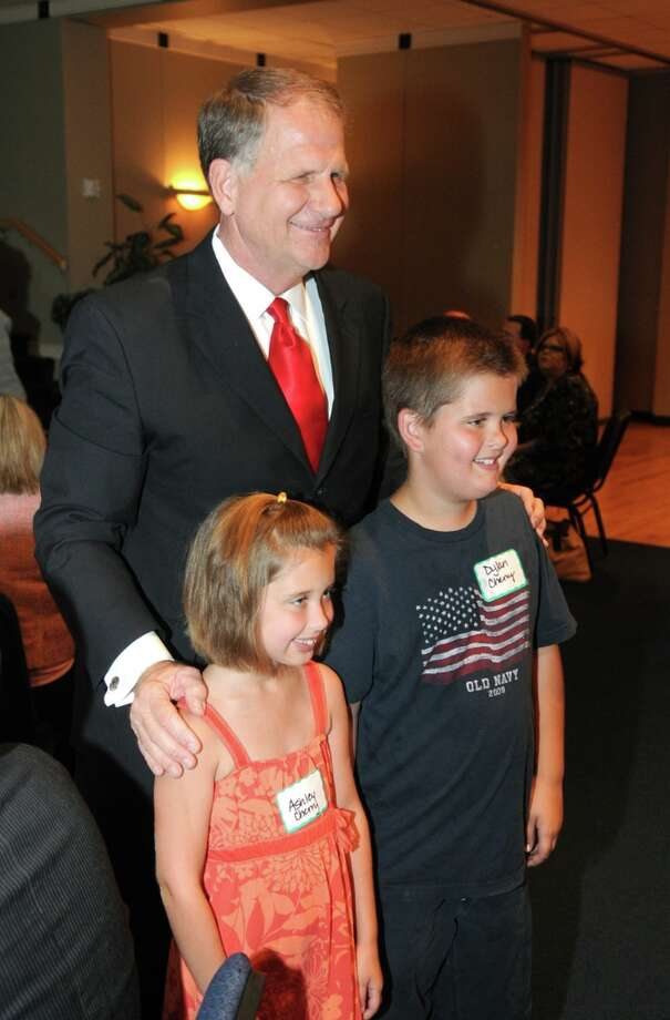 "Congressman Ted Poe, 2nd District of Texas, takes time out for a photo with Ashley Cherry, 8, left, and her brother, Dylan, 10, both students at Oak Forest Elem. in Humble, at the ""Heroes Lunch"" at the Kingwood Chamber of Commerce meeting at The Nathaniel Center in Kingwood. Photo by Jerry BakerAshDylan Photo: Jerry Baker, For The Chronicle / Freelance"