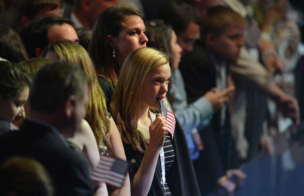 Supporters of US presidential candidate Mitt Romney react during Romney's election night event on November 6, 2012 in Boston. President Barack Obama swept to re-election, forging history again by transcending a slow economic recovery and the high unemployment which haunted his first term to beat Republican Mitt Romney.      AFP PHOTO/Stan HONDA Photo: STAN HONDA, AFP/Getty Images / 2012 AFP