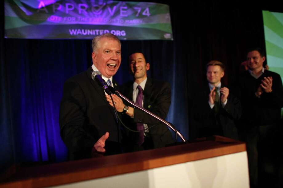 State Senator Ed Murray reacts after his partner Michael Shiosaki gave him a kiss onstage after the initial returns on Referendum 74 during a party at the Westin Hotel on Election Day, Tuesday, November 6, 2012. Photo: JOSHUA TRUJILLO / SEATTLEPI.COM
