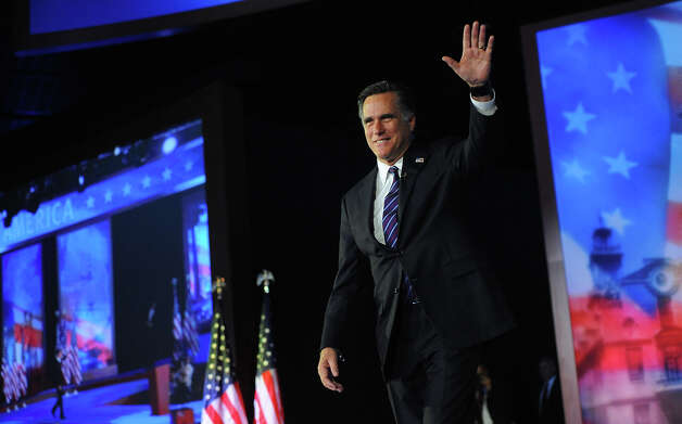 Republican presidential candidate Mitt Romney arrives on stage on election night November 6, 2012 in Boston, Massachusetts, moments before conceding defeat to US President Barack Obama in the 2012 US presidential election.     AFP PHOTO/EMMANUEL DUNAND Photo: EMMANUEL DUNAND, AFP/Getty Images / 2012 AFP