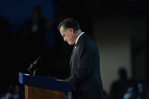 US Presidential candidate Mitt Romney speaks on election night November 7, 2012 in Boston, Massachusetts. Romney conceded the election to US President Barack Obama. AFP PHOTO/Stan HONDA Photo: STAN HONDA, AFP/Getty Images / 2012 AFP