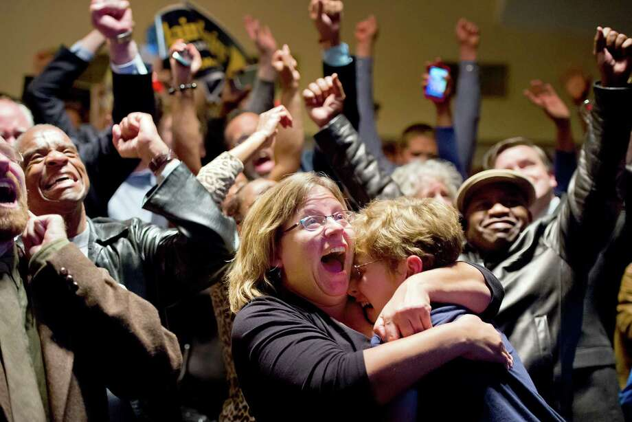 Michelle Zielinski, center, hugs Jared Goudsmit after President Barack Obama is projected to win during an election watch party at the Chase Park Plaza Hotel in St. Louis, Missouri, on Tuesday, November 6, 2012. Photo: DAVID EULITT, McClatchy-Tribune News Service / Kansas City Star