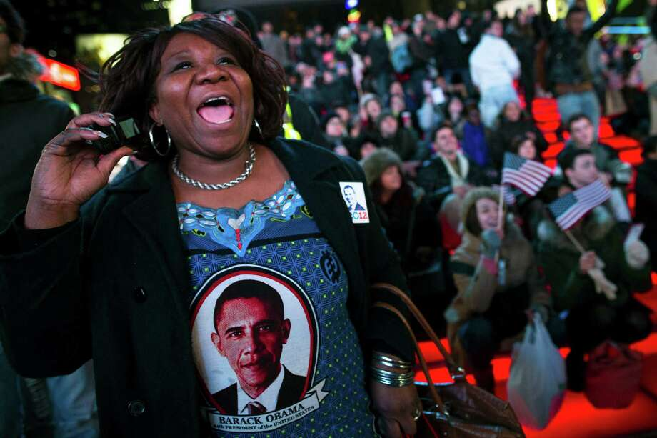Martha Nunez, 53, of the Bronx, reacts to positive predictions for President Barack Obama as crowds watch election results in Times Square, Tuesday, Nov. 6, 2012, in New York. After a year of campaigning, polls have begun to close after Americans across the United States headed to the polls to decide the winner of the tight presidential race between President Barack Obama and Republican presidential candidate, former Massachusetts Gov. Mitt Romney. Photo: John Minchillo, Associated Press / FR170537 AP