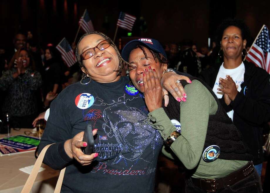 Anita Flanigan, left, and Renee Drake react after President Obama reaches the 270 Electoral College votes during the Michigan Democratic election night party at the MGM Grand Detroit, following Election Day, early Wednesday, Nov. 7, 2012. Photo: Carlos Osorio, Associated Press / AP