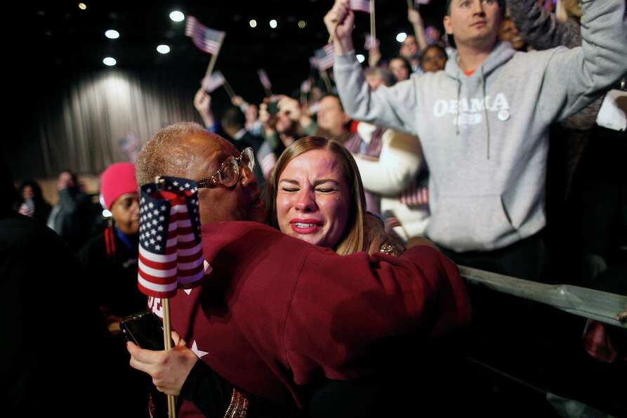 Supporters of President Barack Obama react to favorable media projections at the McCormick Place dur