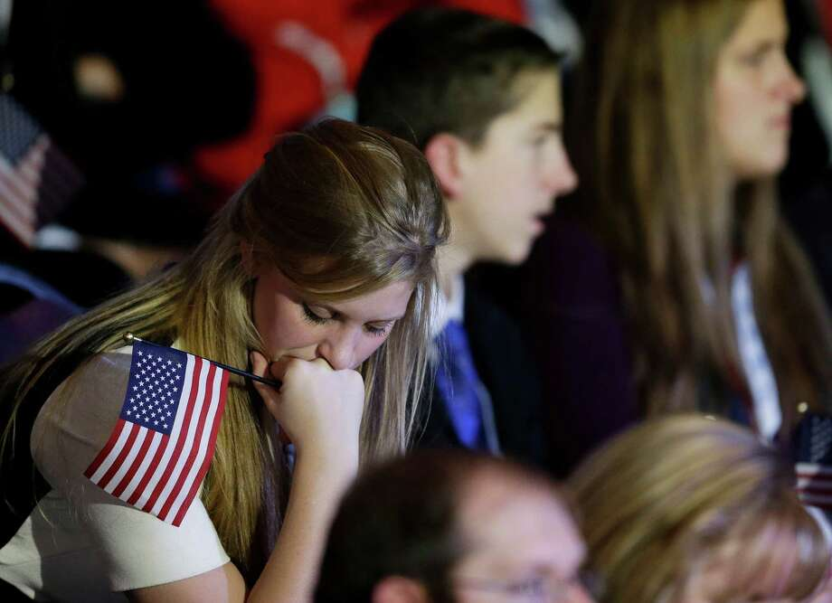 A supporter reacts to voting results displayed on a television screen during Republican presidential candidate and former Massachusetts Gov. Mitt Romney's election night rally, Tuesday, Nov. 6, 2012, in Boston. Photo: David Goldman, Associated Press / AP