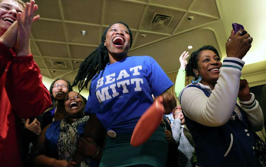 Starlette Dossou and Rachelle Zanders both of Des Moines, Iowa, celebrate after projections that President Barack Obama was the winner of the election during an election night rally, Tuesday, Nov. 6, 2012, in Des Moines, Iowa. Photo: Justin Hayworth, Associated Press / FR170760 AP