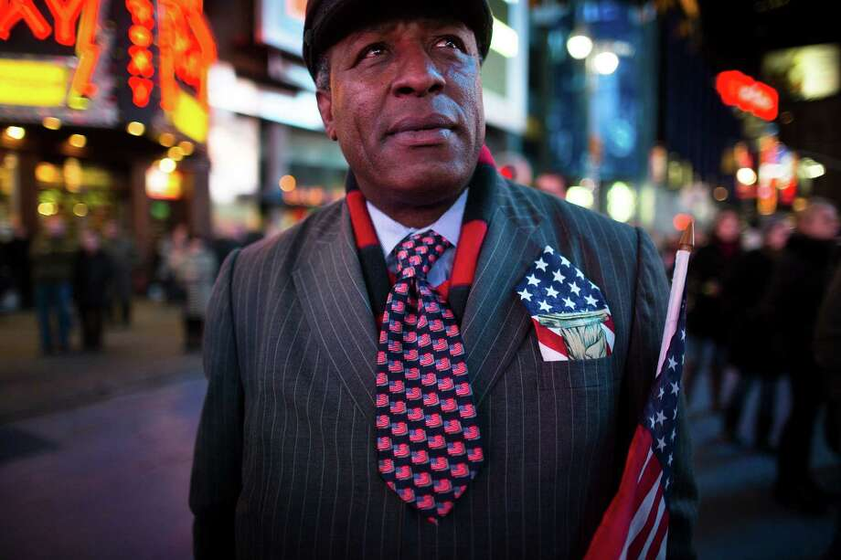 Howard Nizebeth, 48, watches election results in Times Square, Tuesday, Nov. 6, 2012, in New York. After a year of campaigning, polls have begun to close after Americans across the United States headed to the polls to decide the winner of the tight presidential race between President Barack Obama and former Massachusetts Governor Mitt Romney. Photo: John Minchillo, Associated Press / FR170537 AP