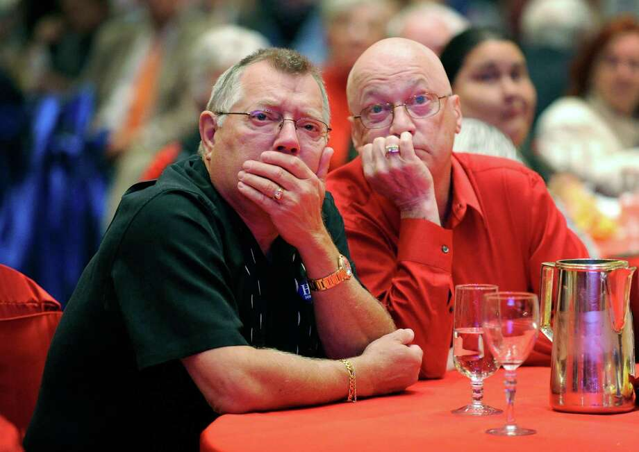 Romney supporters Rodney Paseka (L) and Gary Fox watch the returns during an election night watch party at The Venetian on November 6, 2012 in Las Vegas, Nevada. Voters went to polls in the heavily contested presidential race between incumbent U.S. President Barack Obama and Republican challenger Mitt Romney. Photo: David Becker, Getty Images / 2012 Getty Images