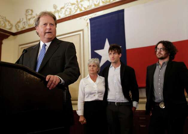 Democratic candidate for U.S. Senate Paul Sadler, left, makes a concession speech at the Texas Democratic Party election watch party, Tuesday, Nov. 6, 2012, in Austin, Texas. With Sadler, from left, are his wife, Sherri, and sons Joel and Lee. Sadler was defeated by Republican Ted Cruz. (AP Photo/Eric Gay) Photo: Eric Gay, Associated Press / AP