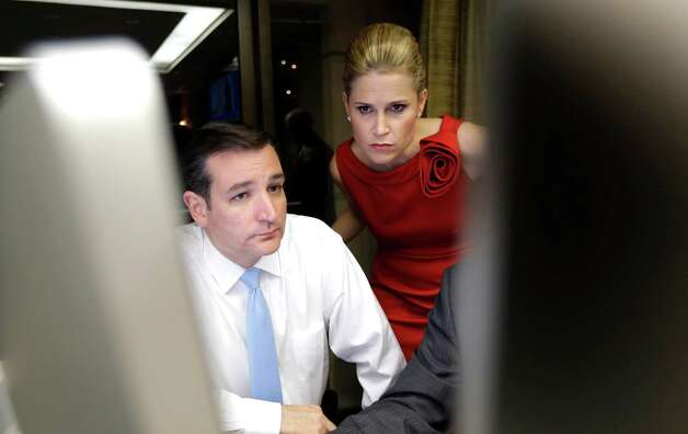 Republican candidate for U.S. Senate Ted Cruz, left, and his wife Heidi watch election results Tuesday, Nov. 6, 2012, in Houston. Cruz is running against Democrat Paul Sadler to replace retiring U.S. Sen. Kay Bailey Hutchison. (AP Photo/David J. Phillip) Photo: David J. Phillip, Associated Press / AP