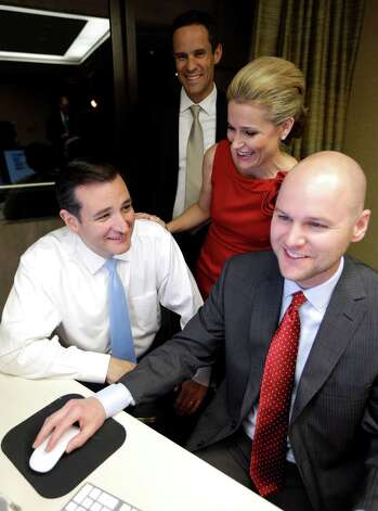 Republican candidate for U.S. Senate Ted Cruz, bottom left, smiles as he goes over election results with his wife Heidi, back right, her brother Scott Nelson, back left, and campaign chief consultant Jason Johnson, bottom right, Tuesday, Nov. 6, 2012, in Houston. Cruz is running against Democrat Paul Sadler to replace retiring U.S. Sen. Kay Bailey Hutchison. (AP Photo/David J. Phillip) Photo: David J. Phillip, Associated Press / AP